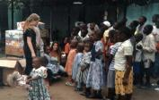 "Lisa (right: with Naomi) distributing shoes, clothing and toys at the ""Remar"" orphanage where we did several shows."