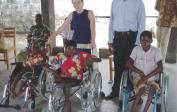 "Genevieve with children in our wheelchairs at the ""Kikesa"" Center."