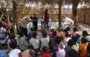 Mokali: P. Theophile, Marie and some of the children dramatising a bible-story,...