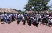 The pupils of Kakondo school stand in formation and greet us with loud singing & dancing.