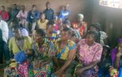 Fathers (left) and mothers (right) from Mushapo at a parent meeting in our school.