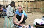 7. Above: Lenka distributes shoes in Mokali in Congo